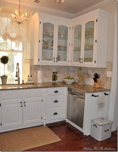 love the towel bar on the end base cabinet from Peeking thru the Sunflowers