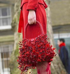 This is an amazing purse-covered with red buttons