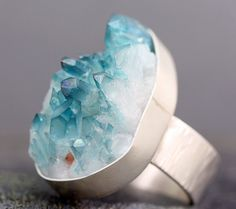 aqua aura quartz crystal ring, $110.. I love this stone.. I don't like the ring so much, but have been searching for an aqua aura for a long time in a ring.. I have a bunch of the stones..
