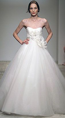 I like the tulle...feels fun. and reminds me of dancing.  Her shoulders are painful to look at though.