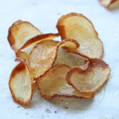 Parsnip Chips...I make potato chips like this all the time. Next time I think I will try parsnips instead!