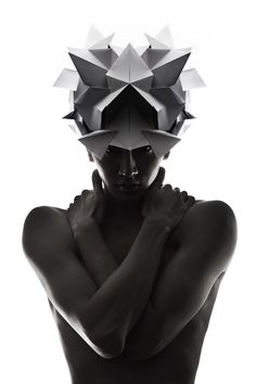Origami headgear folded to resemble mythological creatures Mode Origami, Origami Hat, Oragami, Photography Poses, Fashion Photography, Photography Composition, Geometric Fashion, Origami Fashion, Body Adornment