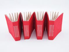 "west cermak : bookmaking : mini red notebooks : utilized ""scrap"" materials"