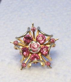 Hey, I found this really awesome Etsy listing at https://www.etsy.com/listing/183527551/vintage-unique-pink-stone-and-rose