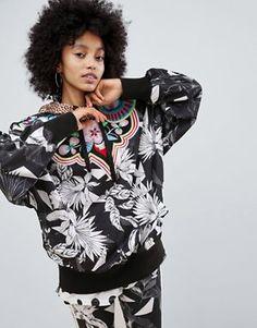 f8aa4c43c9e Shop adidas Originals X Farm Multi Print Hooded Windbreaker Jacket at ASOS.