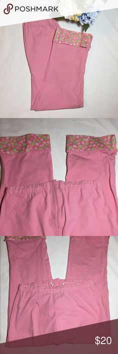 Lilly Pulitzer size medium capris Pink capris with wire flower and pineapple hems. Size is P. See sizing chart for size. Drawstring and zipper waist. Eye hock is lose but easy to fix.     Waist28 inches.                                           In seam 22 inches. Lilly Pulitzer Pants Capris