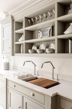 TRAY STORAGE - Built into Kitchen.  Like this. Add to spec.