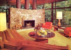 Stone and wood I like the columns above this stone fireplace. How about something like this or grate above a fireplace in between the lower and upper areas of the lobby?  Mid-century Modern living room by army.arch, via Flickr