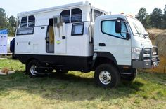 EarthCruiser EXP with pop-top at Overland Expo 2014