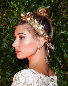 20 Holiday Party Hairstyles to Copy This Season | Messy, Accessorized Bun | Hailey Baldwin 2016