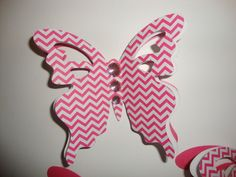 6 bright pink and white chevron 3d butterflies- wall decorations- nursery decor- wedding- customize colors- baby shower. $18.00, via Etsy.