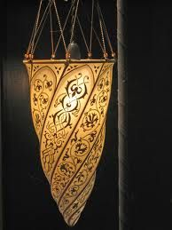 Love, love, love my Fortuny lamp that we bought in Venice, Italy.