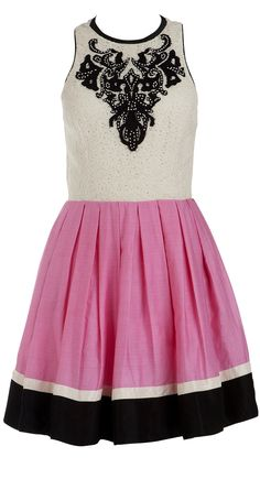 I like this dress because the contrast between the black and white really captures your attention. I love the pink in the middle, which makes it more interesting and appealing to your eye.