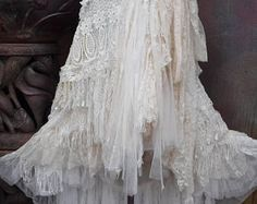 wedding skirt,tattered skirt, stevie nicks, bohemian skirt, boho skirt, gypsy skirt, lagenlook skirt,OAK, shabby wrap skirt..  she,s an absolutely gorgeous bohemian wrap around shabby skirt in ivory and off white hues kissed with cotton broderie anglaise,assorted bridal laces,beaded bridal decals,netting,rose trims,crochet,butterflies and shabby detail with roses where she ties giving her a shabby chic feel.....these pieces are works of art and sell way below their worth so grab something…