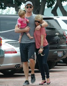 Daddies girls: Chris Hemsworth was seen carrying his daughter India while cuddling his wife Elsa Pataky as the trio spent time in Malibu