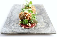 This venison carpaccio recipe is a twist on a classic beef carpaccio with the addition of a crispy venison shoulder lollipop and a delicious shallot and hazelnut vinaigrette.I like cooking with ga…