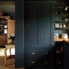Dark kitchen cabinets in a beautiful design by devol! Pantry Cupboard, Kitchen Pantry, New Kitchen, Kitchen Cabinets, Black Cabinets, Kitchen Ideas, Kitchen Layout, Grey Cupboards, Kitchen Decor