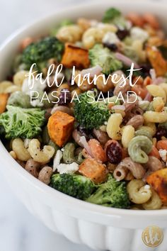 Roasted sweet potato, broccoli, cranberries, and toasted pine nuts give this pasta salad a festive fall flair!
