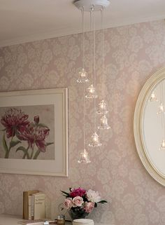 Laura Ashley. Beautiful wall paper and little hanging lights. Lovely!