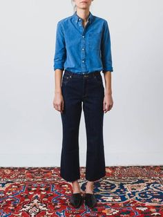Wide cut jeans made in Indigo Japanese denim. This stiff material will wear in over time, and lighten with washing. - Straight, rather short leg - Loose silhouette - Enveloping mid-rise - Zip fly - Br