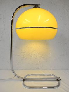 "Vintage Mid Century Atomic Mushroom Table Lamp, Space Age Guzzini Desk Lamp Perfect condition, spectacular, ready to plug in. Authentic mid century table light, Guzzini and Panton style, unsigned. Large 13"" diameter suspended dome, cream color plastic, chrome base and neck. Lamp measures 27"" tall."