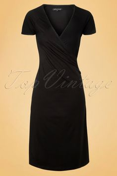 This elegant50s Cross Dressis a true vintage beauty and perfect for any occasion!The fitted top features a beautiful wrap neckline that is both suited for a fuller and a more modest cup size ;-) Super flattering for your figure thanks to the playful A-line and side ruches that will mask any tummy flaws. Made from a supple, stretchy, black viscose blend that's a dream to wear. This super versatile beauty is a real must!Pregnant? Then you're all set with this stunner!   A-line V-Neckline…