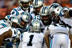Quarterback Cam Newton #1 of the Carolina Panthers talks to his team in a huddle in the first half against the Denver Broncos at Sports Authority Field at Mile High on September 8, 2016 in Denver, Colorado.