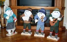 Here are the NL. Mummers that I make. The instruments are made from pine. These little guys are popular around Christmas time.