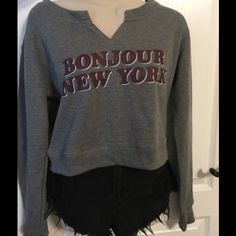 Long Sleeve Cropped Sweater Long sleeve cropped sweater with the words of Bonjour New York on the front. Cotton On Sweaters
