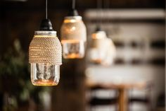 DIY rope-wrapped Mason jar hanging lights via A Pair & A Spare   Remodelista