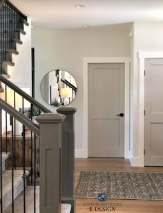 Entryway with Benjamin Moore Edgecomb Gray lightened, Revere Pewter painted doors, white trim, dark painting stair railing. Kylie M Interiors Edesign, online paint color consulting Grey Interior Doors, Interior Door Colors, Painted Interior Doors, Interior Trim, Painted Doors, Farmhouse Interior Doors, Entryway Paint Colors, Interior Door Styles, Interior Painting