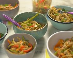 Ellie Krieger Asian Noodle Bowl with Peanut Dressing - Ingredients 8 ounces whole wheat spaghetti 1 teaspoon peanut oil or canola oil 1/3 cup unsalted peanuts 1 ½ cups snow peas (¼ pound), trimmed and thinly sliced lengthwise 2 small carrots, shredded into thin strips with vegetable peeler 1 medium red bell pepper, thinly sliced into strips 3 scallions, green and white parts, thinlyRead More #wholewheatpastarecipecups