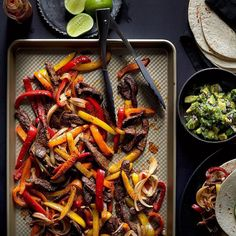 Roast flank steak, peppers and onions on a sheet pan for a quick + easy fajita dinner! For the recipe, tap the link in our Instagram profile. #OnePotWednesday