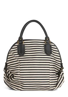 How Striped Is Now? Bag. Theres no better time to add stripes to your wardrobe than the present, especially with this ivory-and-charcoal striped bag by Fredd  Basha. #black #modcloth