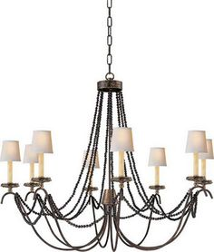 living rm? smaller version for dining or stairwell? Marigot Eight Light Chandelier With Wood Beads - CHC1413