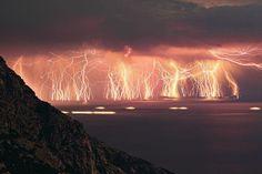 70 lightning shots, taken at Ikaria island, Greece. By Chris Kotsiopoulos