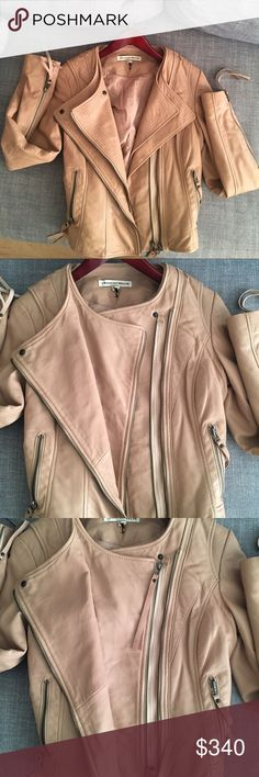 Super cool peachy beige leather biker jacket sz 8 Twenty 8 twelve brand high quality buttery soft leather. This jacket will turn heads and has double zippers you can zip just one and leave the other one open. The back is unique as well there is one slight discoloration mark on the back from when I leaned up against something it may come out with a professional cleaning but it's not that noticeable. The color is just like the photos a peachy beigey great neutral and will match everything…