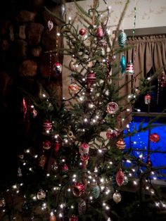 I love this tree full of vintage Christmas ornaments!