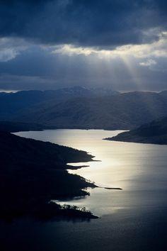 sunlight on a Highland loch, Scotland