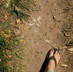 In the Killing Fields of Cambodia. Bones are still visible in the ground.