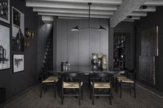From Maison Hand, this dramatic dining room in an apartment in Lyon Saint Georges does dark and moody perfectly.