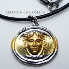 Medusa pendant by Chavdar Chushev. Sterling silver with 24K gold. After an antique gem. Keywords: Medusa Gorgon Athena jewelry pendant silver gold pendant handmade handcrafted ancient jewelry antique jewelry amulet talisman charm  antique jewelry silversmith goldsmith jewellery leather cord necklace mythology statementnecklace luxury shopping jewelry trend designer jewelry
