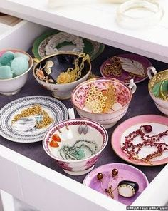 Instead of hanging your smaller pieces of jewelry, organize them in antique dishware. - cheap intimates, lace lingerie, maternity lingerie *ad