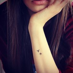 Tiny tattoo. Like how it's so small I would totally get.