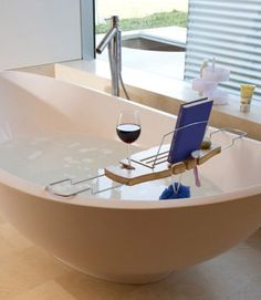 A day at the spa might not be in reach for the ever-busy mom, but this helpful tub shelf (complete with a spot for her glass of red) recreates the experience at home.