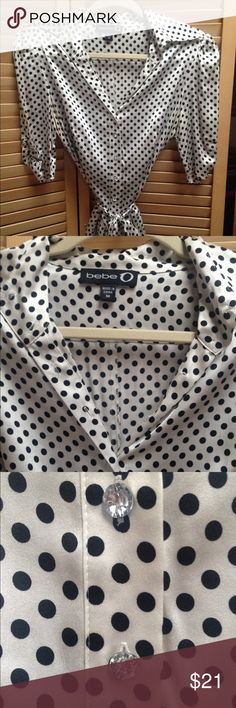 Gorgeous blouse Beautiful silk and spandex polka dot blouse. Silky soft on. Vintage look and feel. Clear buttons down front. Collar. 1/2 sleeves with little gathering of material at ends. Tie belt but could wear without as well. Only wore a few times. EUC Size M Bebe Tops Blouses