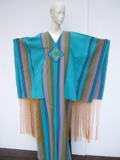 https://www.1stdibs.com/fashion/clothing/day-dresses/1970s-spectacular-angel-wing-caftan-designed-josefa/id-v_502832/
