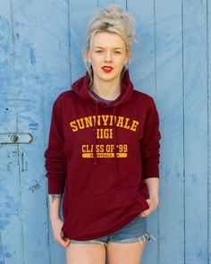 ***SPECIAL MULTI-BUY OFFER*** Buy two items and get 10% off, at the checkout enter: MULTI2  OR  Buy three items and get 20% off, at the checkout enter: MULTI3   Sunnydale High Class of 99 Hoodie - A traditional varsity style design inspired by Joss Whedons cult classic TV series, Buffy the Vampire Slayer. The design is printed locally with eco-friendly water based inks using a traditional silk screen printing method that guarantees a long lasting and durable print. It has been printed onto…