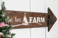 Christmas arrow sign with a stencil offer on FunkyJunkInteriors.net