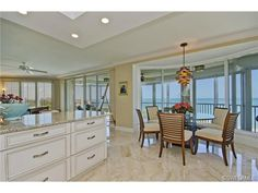 Eat in Kitchen on the Gulf of Mexico - marble floors - white kitchen - contemporary chandelier.  Contessa at Bay Colony | Naples, Florida